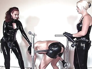 Femdom strapon spitroast in latex blonde brunette bdsm